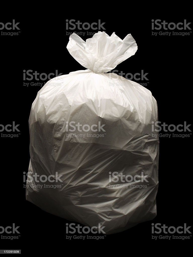 Bag of trash on a black background royalty-free stock photo