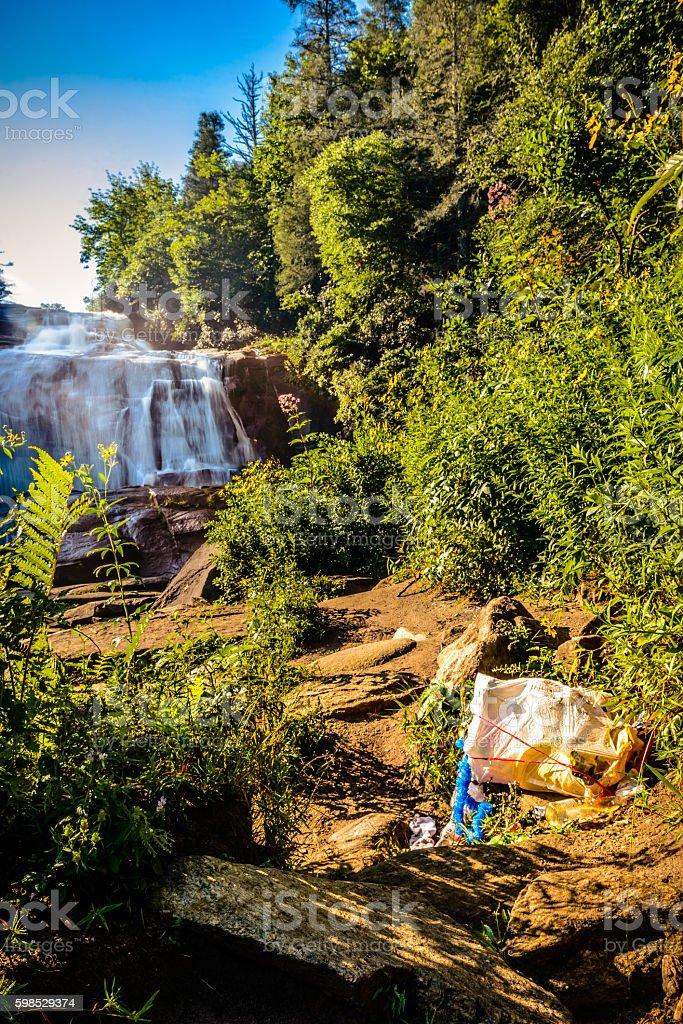 Bag of trash thrown at High Falls stock photo
