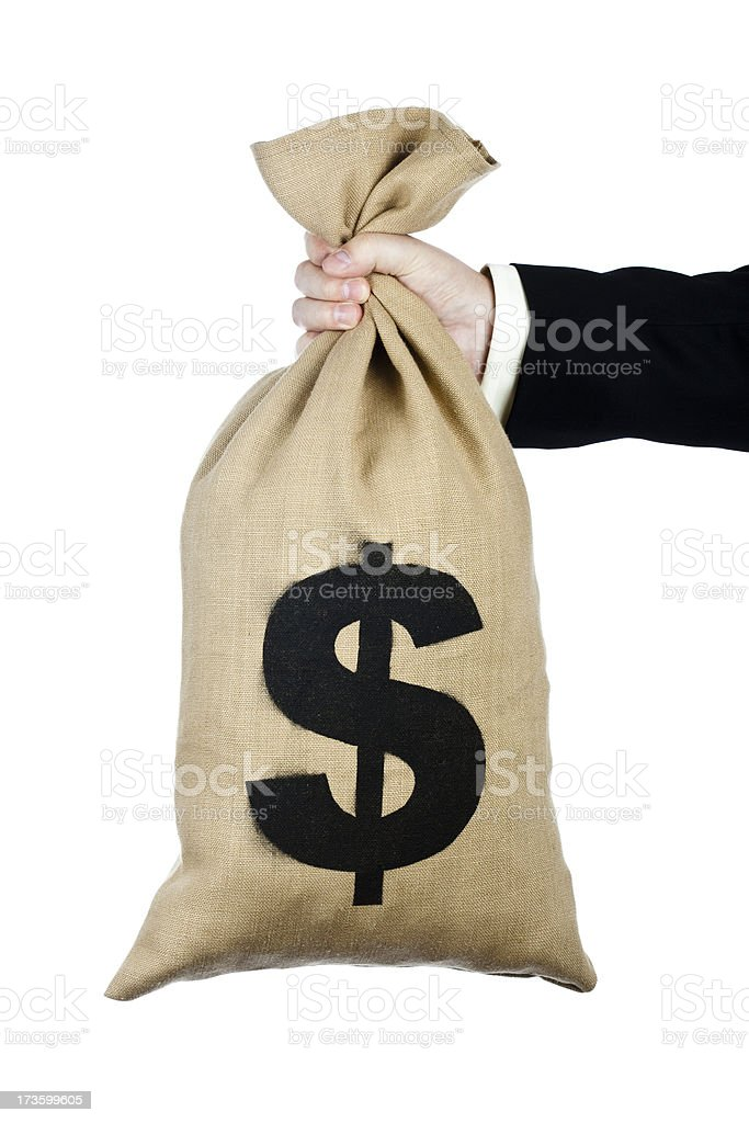 Bag of US dollars held in hand royalty-free stock photo