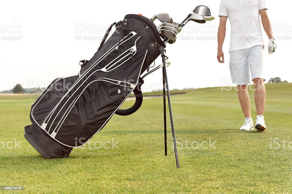 Bag with niblicks on the golf course stock photo