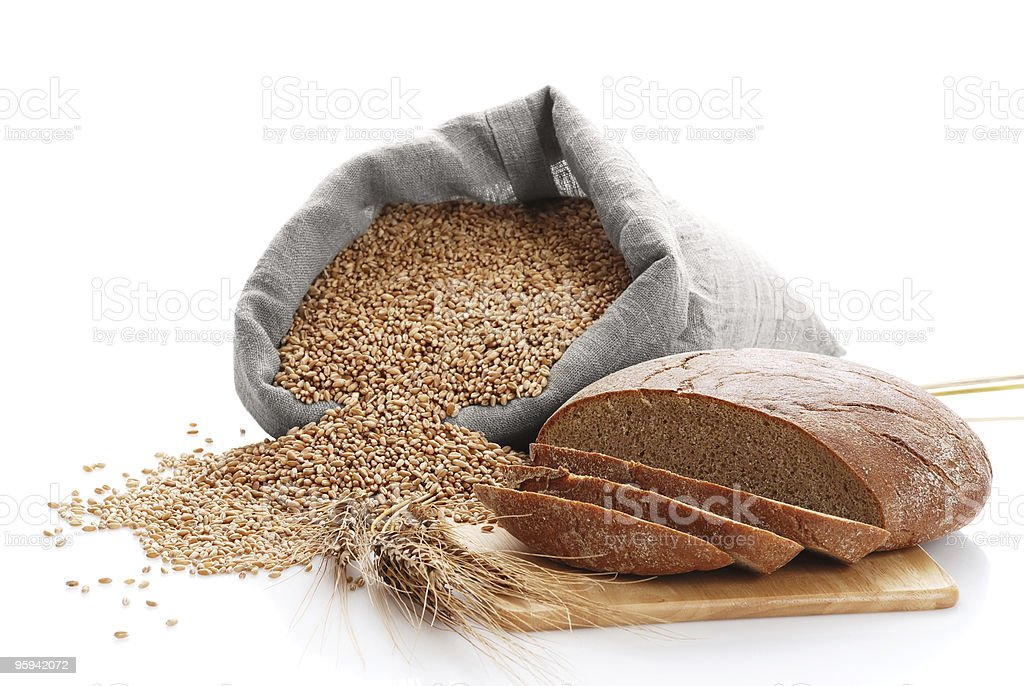 Bag with wheat and bread cut on a board royalty-free stock photo