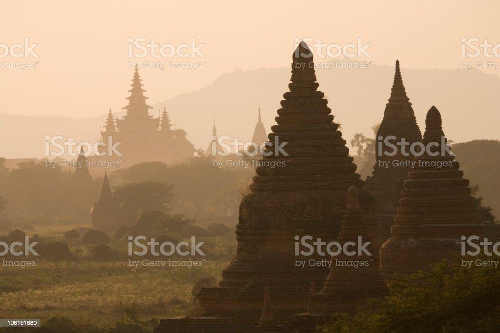 Bagan, Myanmar:  Pagodas in Hazy Evening Light royalty-free stock photo