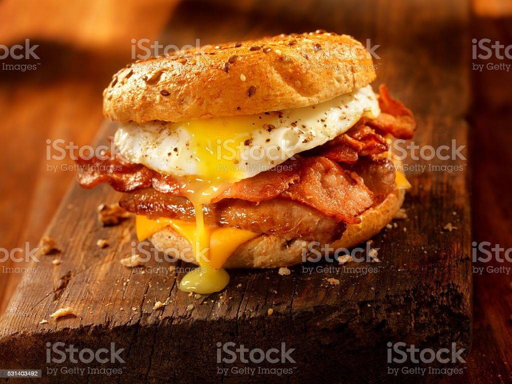 Bagel, Bacon, Sausage and Egg Breakfast Sandwich stock photo