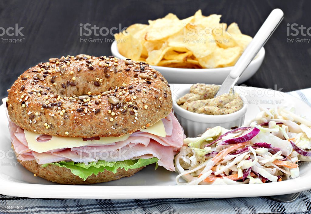 Bagel ham, cheese and lettuce sandwich stock photo