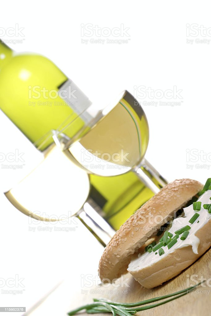 bagel with cream cheese and freshly cut chives royalty-free stock photo