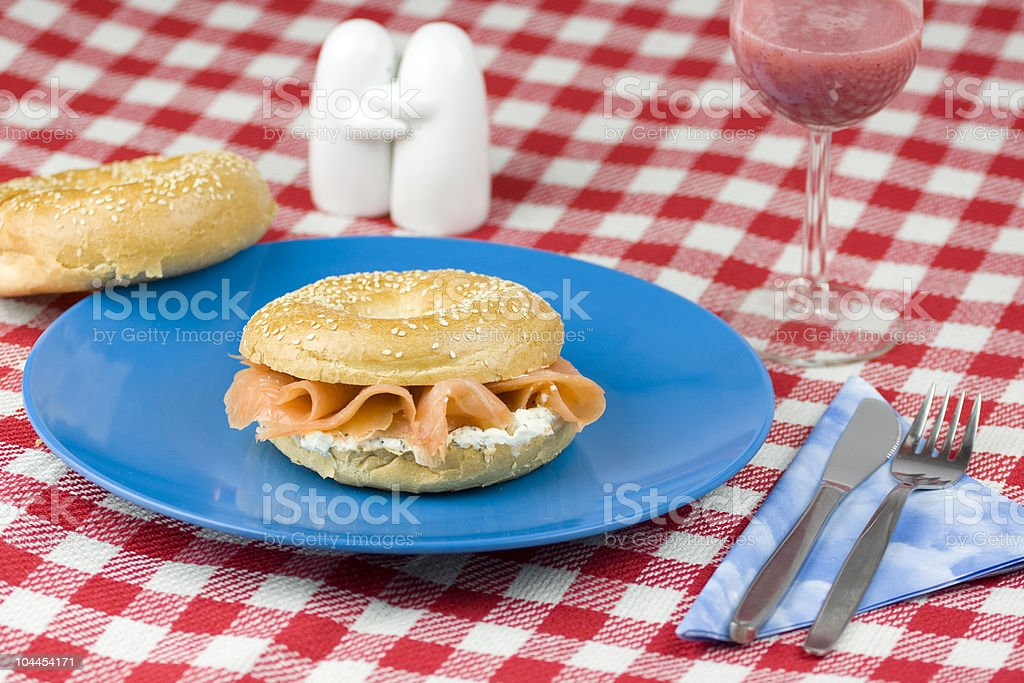 Bagel with freshly smoked salmon royalty-free stock photo