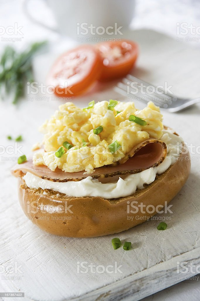 Bagel with Scrambled Egg Topping stock photo
