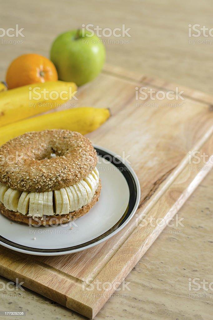 Bagel with sliced banana stock photo