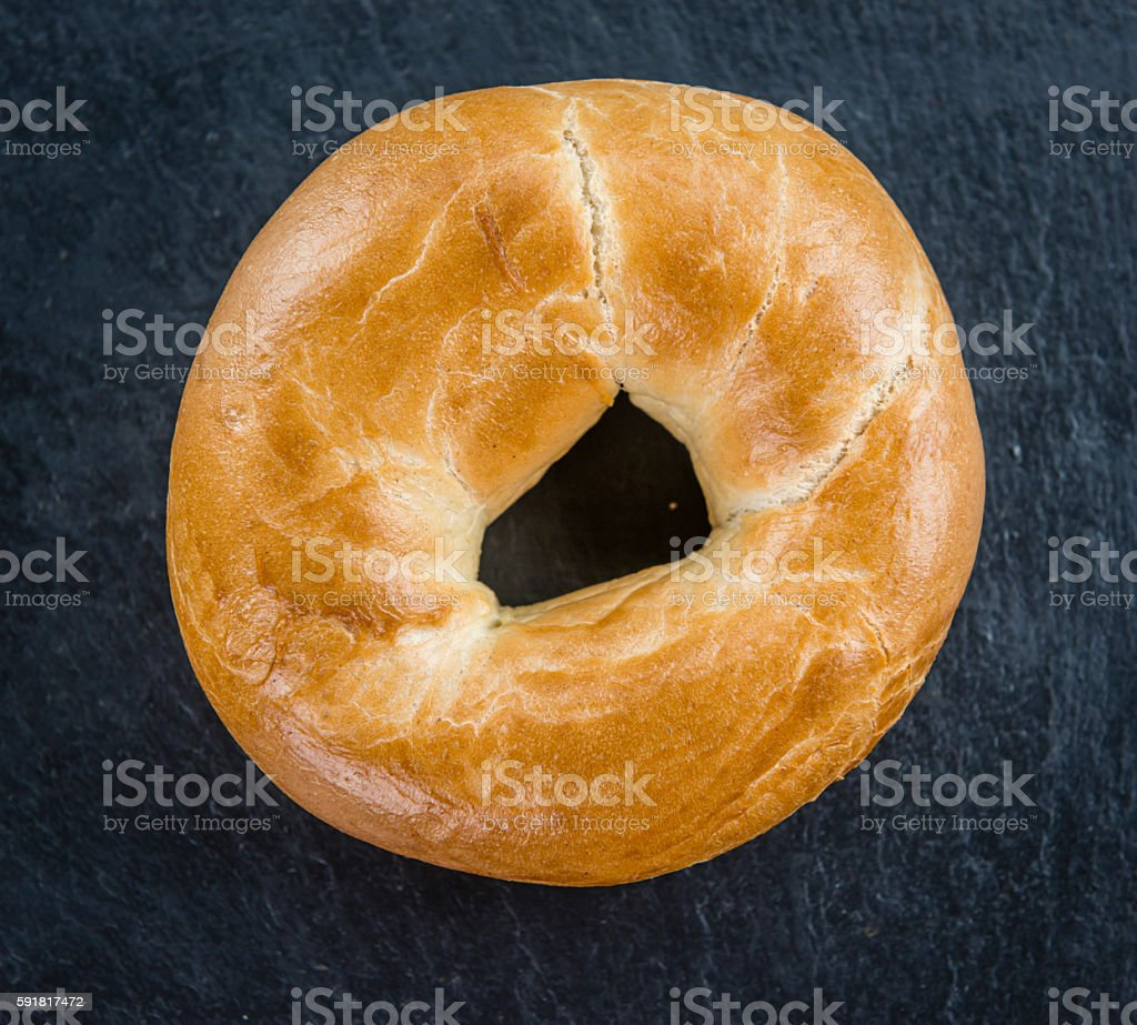 Bagels on a slate slab (selective focus) stock photo