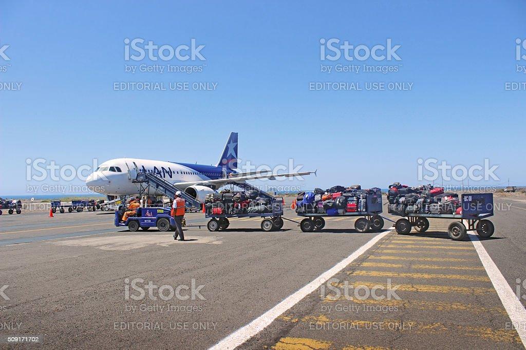 Baggage Handlers on Airport Runway stock photo