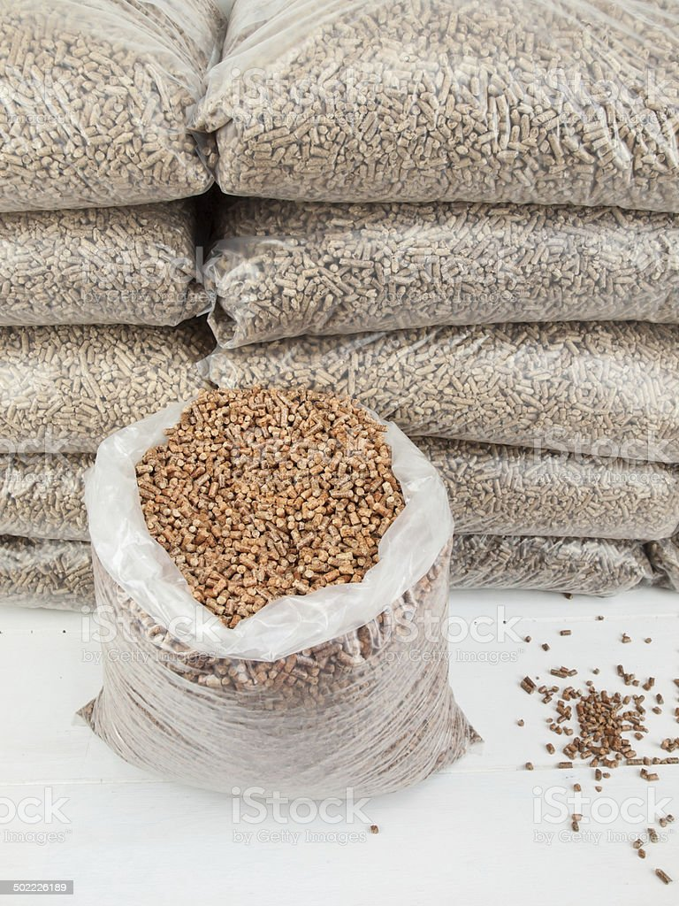 bagged wood pellets in storage stock photo