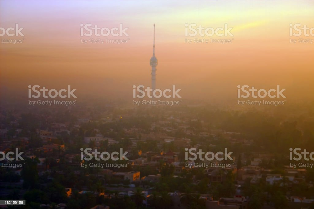 Baghdad sunrise skyline covered in smog stock photo