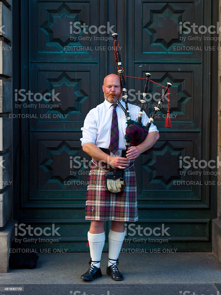 Bagpipe player performing on Royal Mile, Edinburgh, Scotland, United Kingdom. stock photo