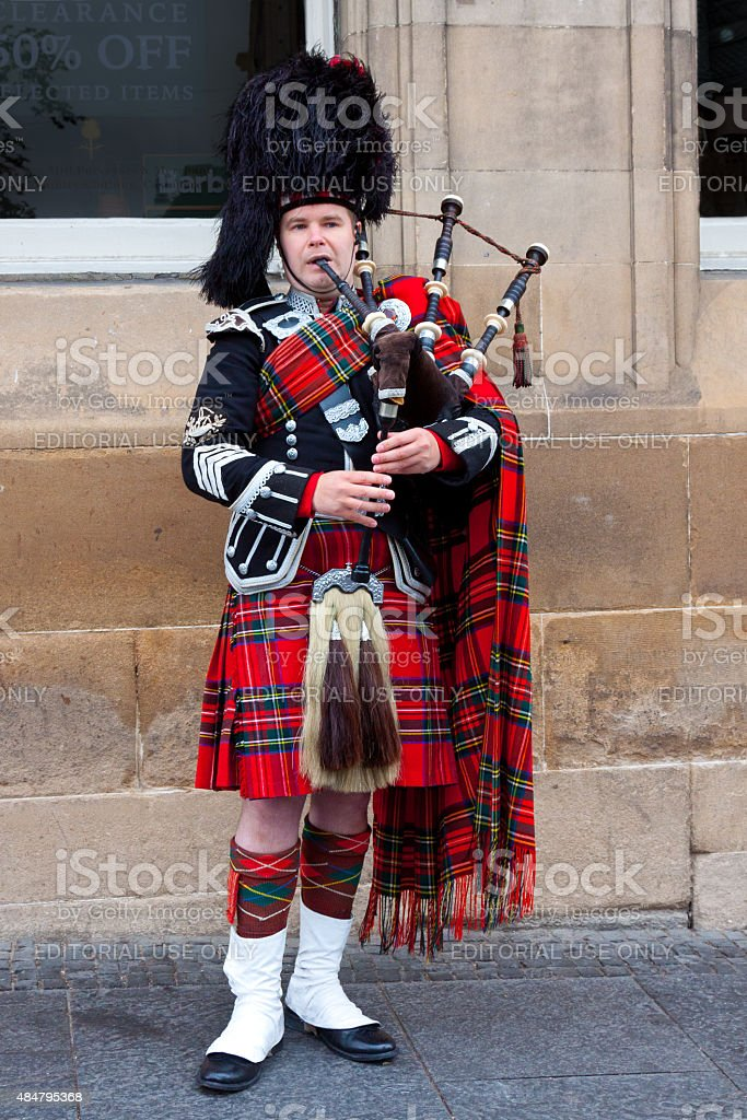 Bagpipe player performing on Royal Mile, Edinburgh, Scotland, United Kingdom, stock photo