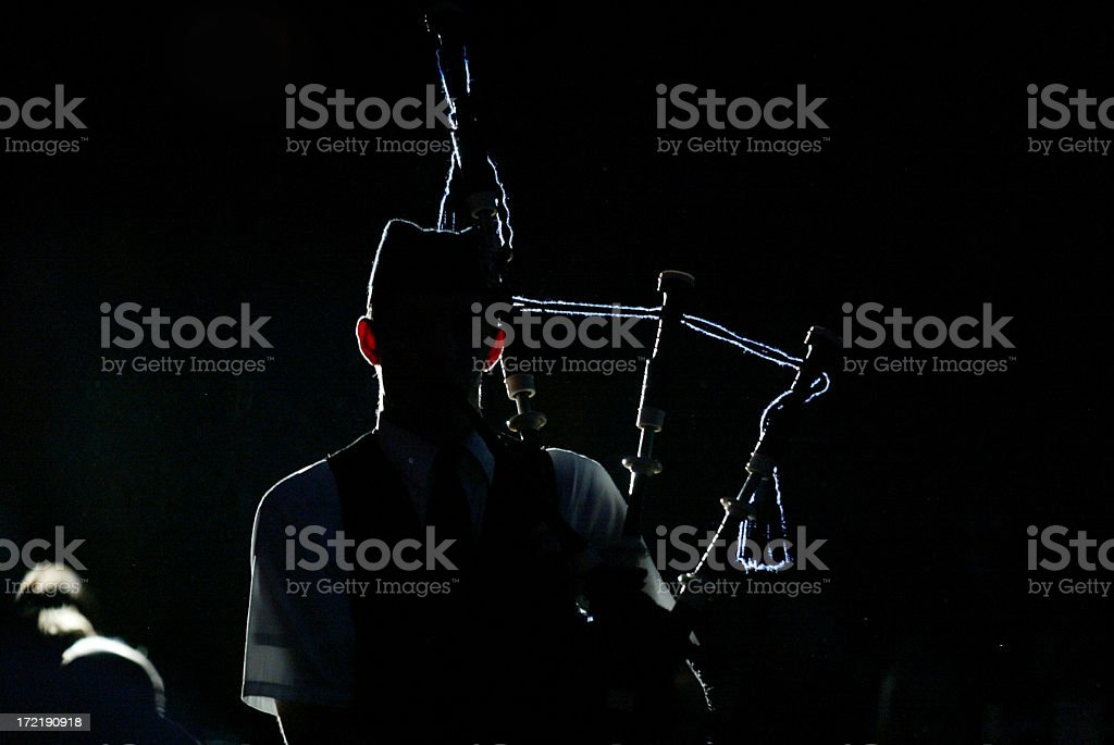 Bagpiper at night royalty-free stock photo
