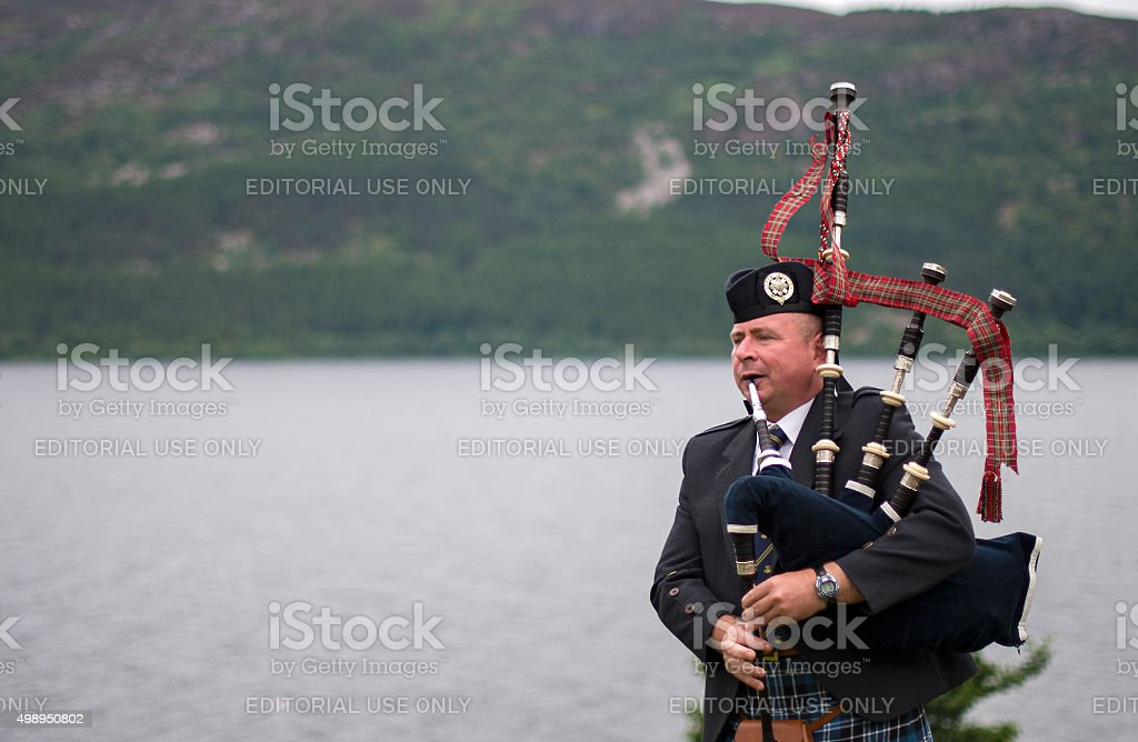 Bagpiper at Urquhart Castle - Loch Ness, Scotland stock photo