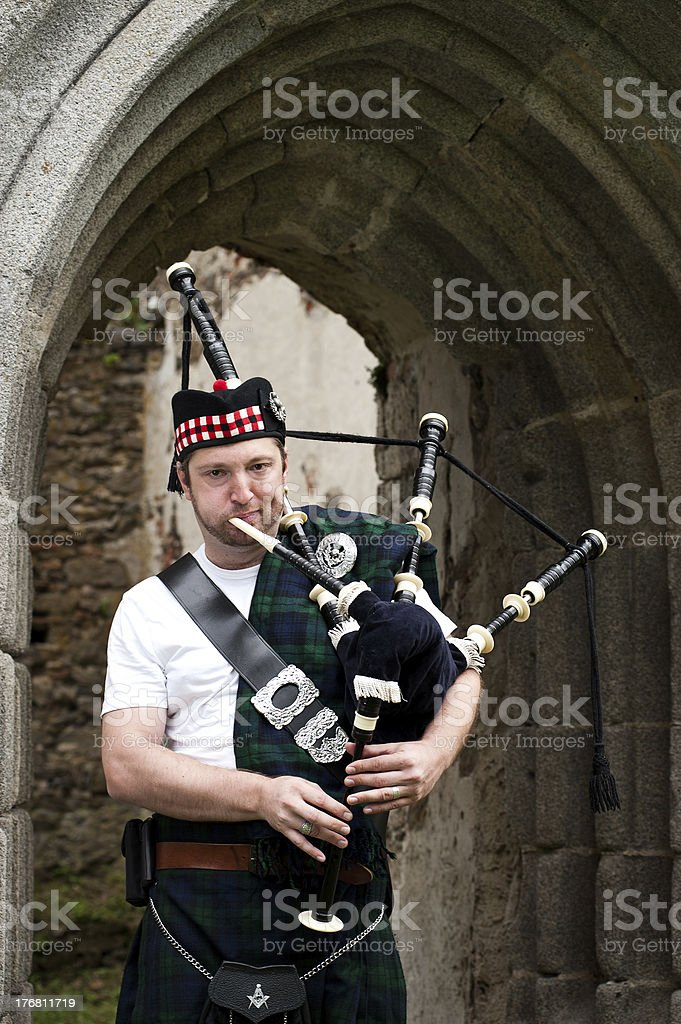 Bagpiper on a medieval Location stock photo