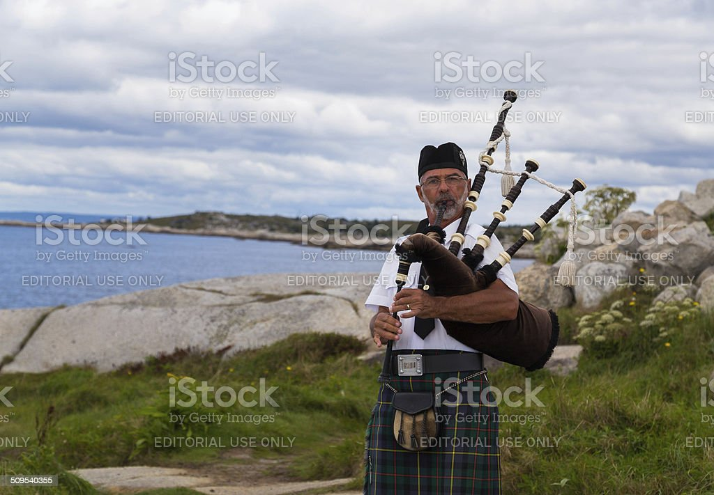 Bagpipes Musician at Peggy's Cove stock photo