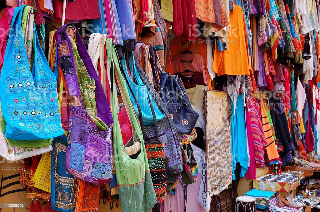 bags and clothes at an oriental market royalty-free stock photo