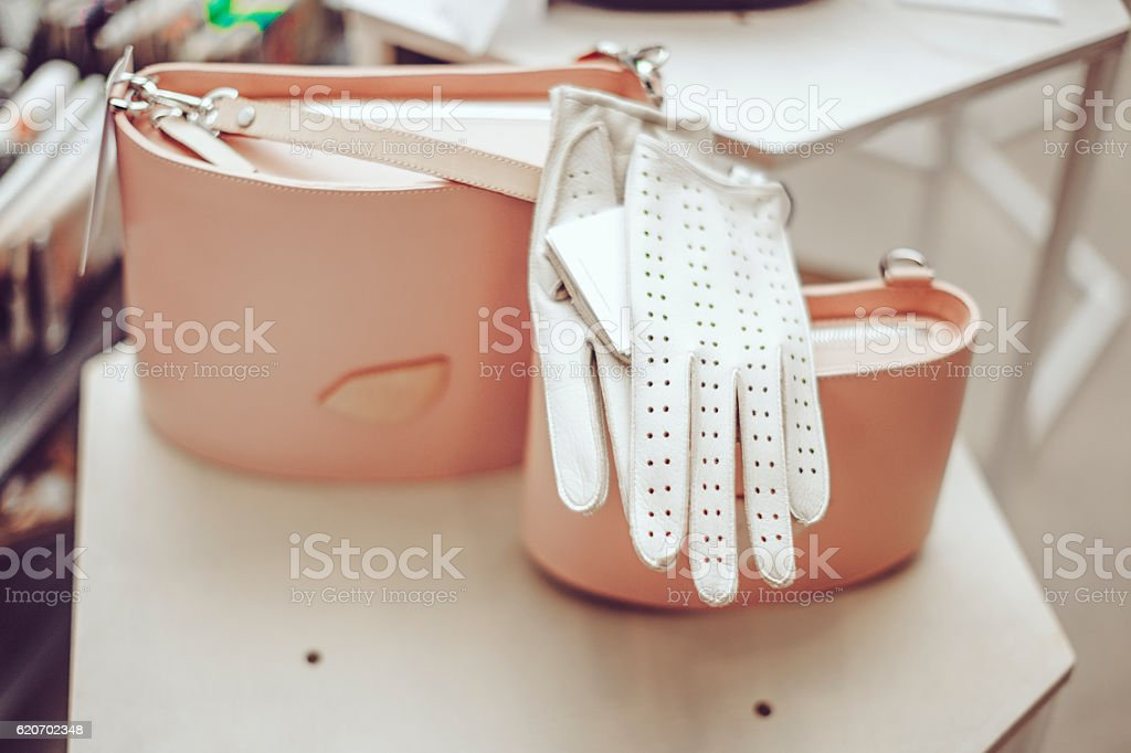 Bags and glove on the shelve stock photo