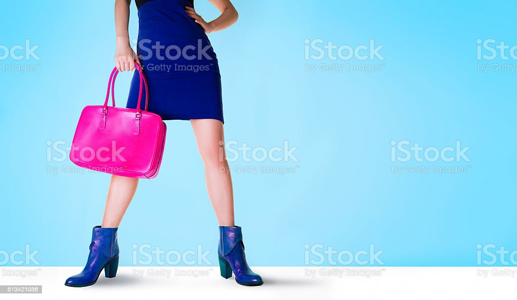 Bags and shoes. Beautiful legs woman. stock photo