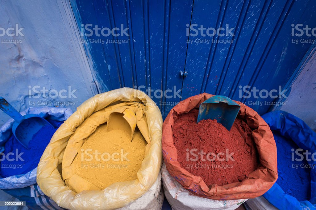 Bags of colorful dye powder in Morocco stock photo