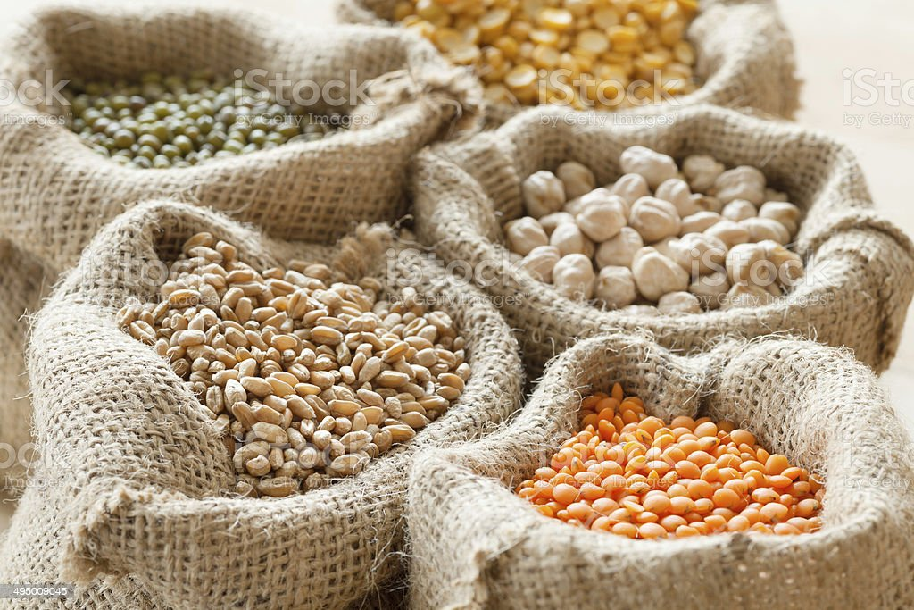 bags with wheat, chick peas, red lentils and green mung stock photo
