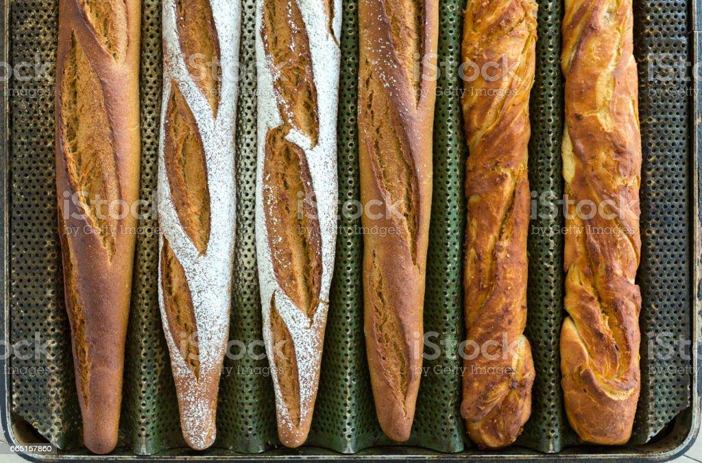 Baguette bread baking on sheet stock photo