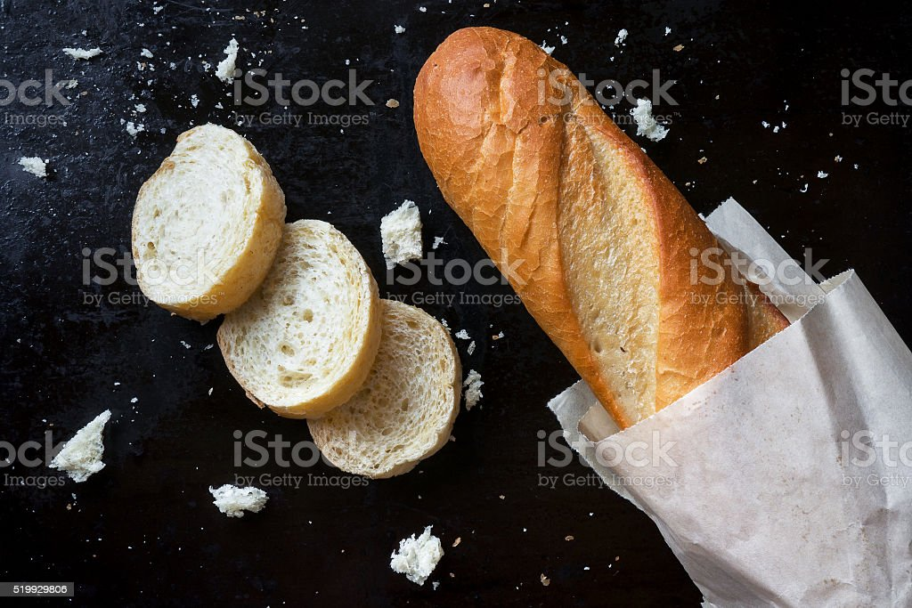 Baguette on dark background stock photo