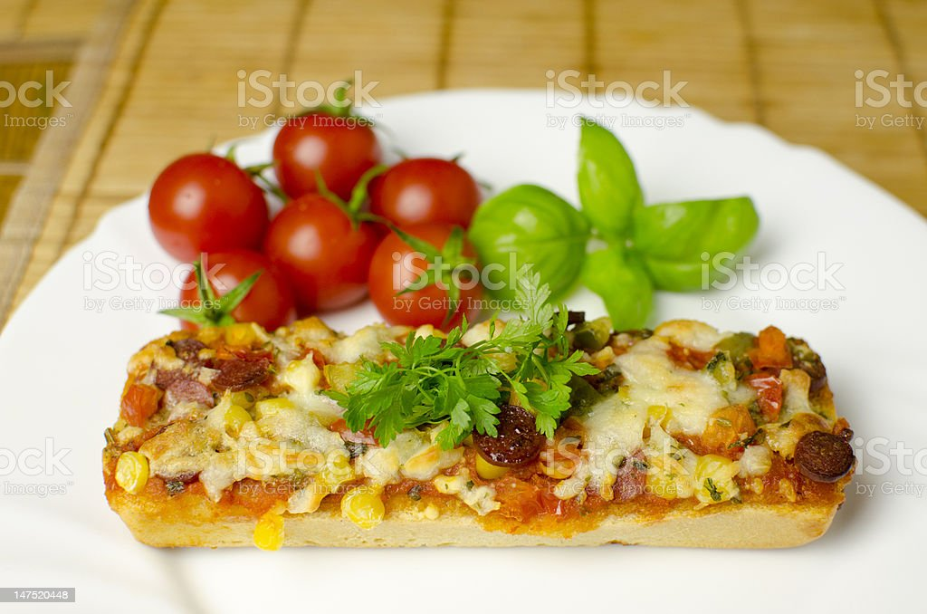 Baguette pizza close-up royalty-free stock photo