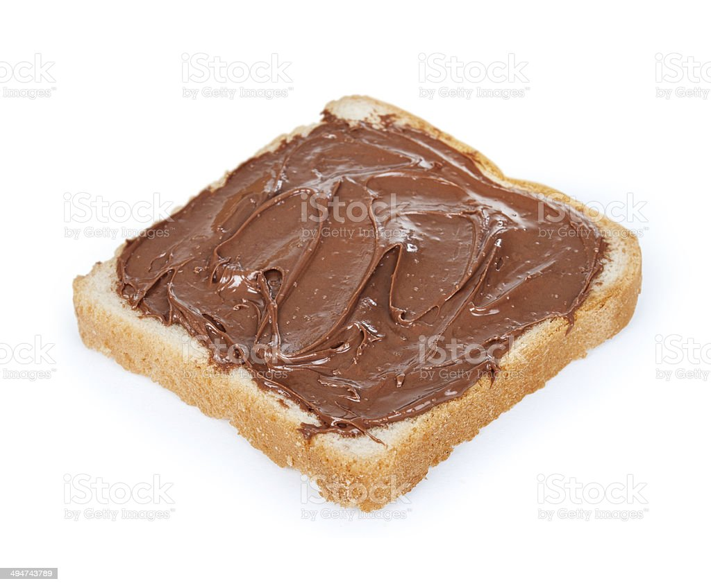 baguette slice spread with nut-choco paste, isolated on white stock photo