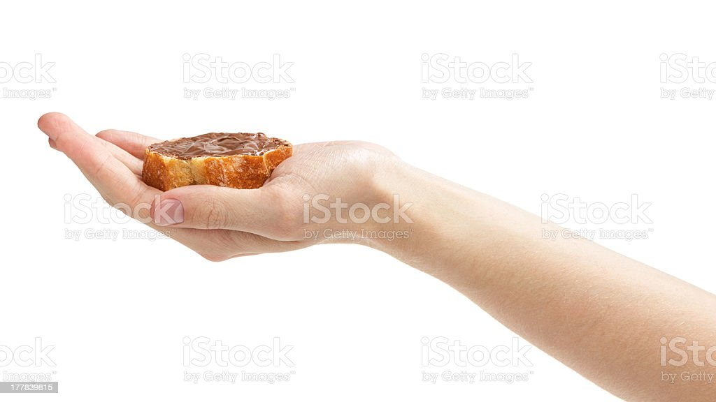 baguette slice spread with nut-choco paste stock photo