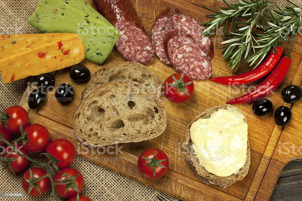 Baguette with salami and fresh cheese royalty-free stock photo