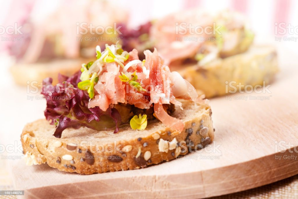 Baguette with salmon tartare and vegetables royalty-free stock photo