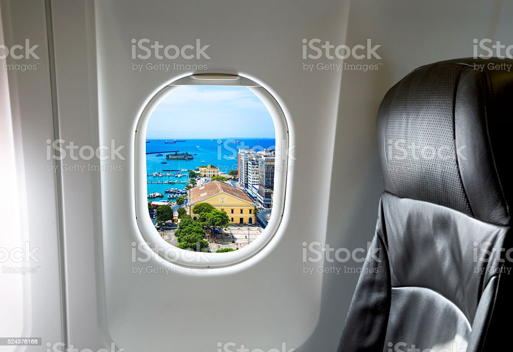 Bahia through aircraft window onto jet engine stock photo