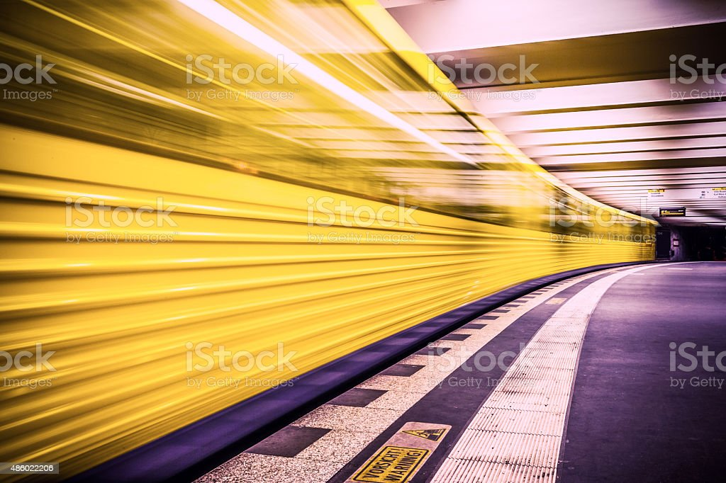 U Bahn subway train leaving station stock photo