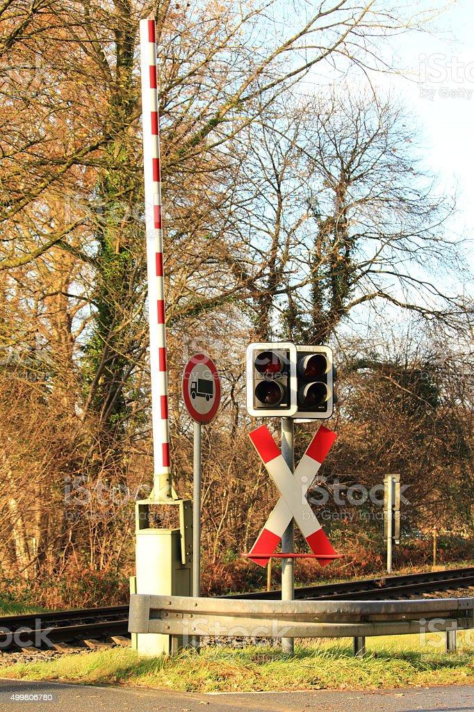 Bahnschranke mit Signal stock photo