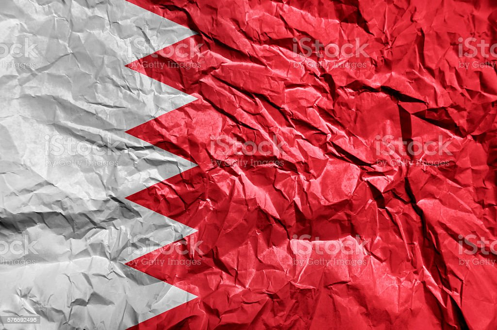 Bahrain flag painted on crumpled paper background stock photo