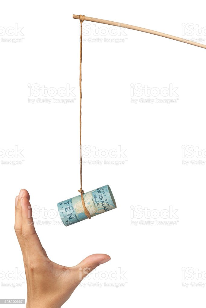 Baiting with New Zealand money stock photo