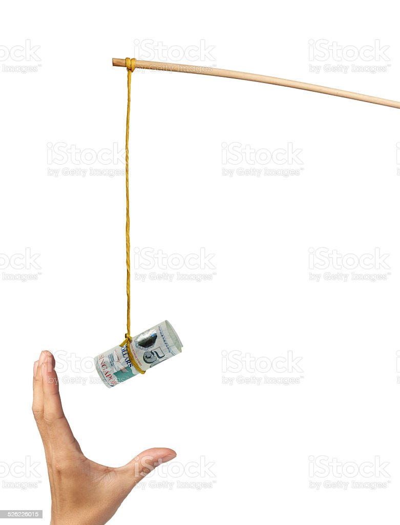 Baiting with Singapore money stock photo