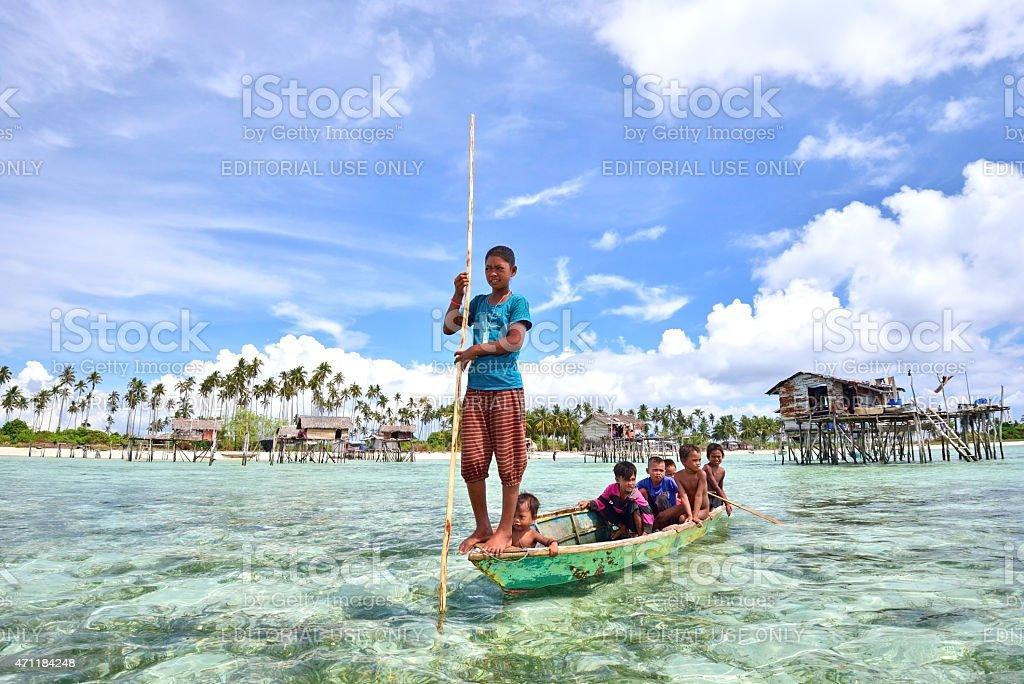 Bajau Sea Gypsies of Borneo on a Boat, Sabah. stock photo