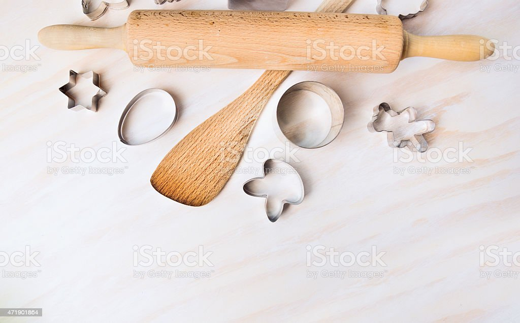 Bake tolls and easter cookie cutters on white wooden background stock photo