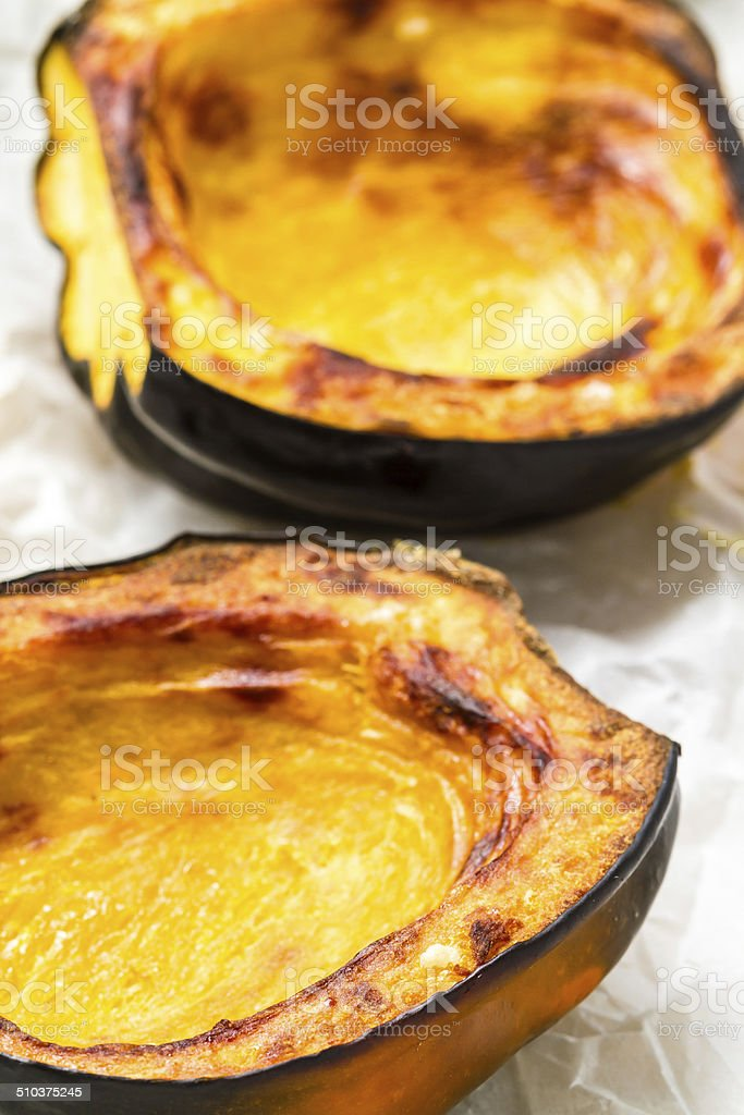 Baked acorn squash stock photo