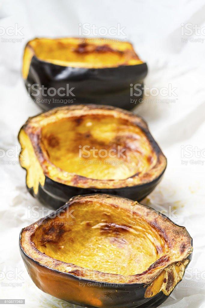 Baked acorn squash stock photo