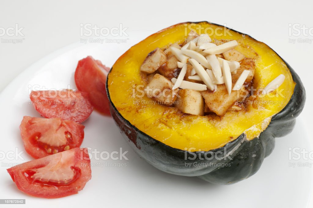 baked acorn  squash with apples and nuts royalty-free stock photo