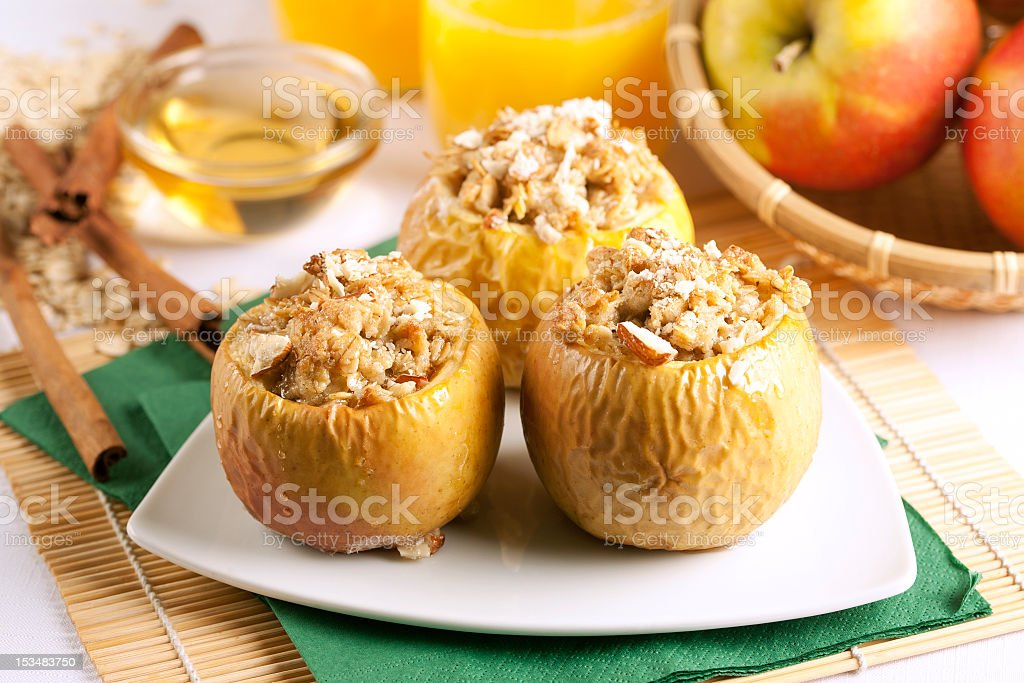 Baked apple stuffed with bread pudding stock photo