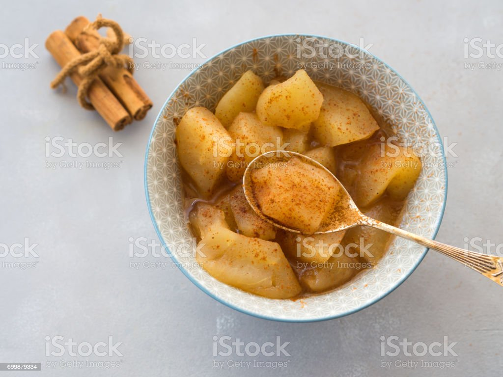 Baked apple with cinnamon stock photo