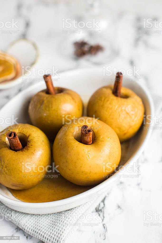 baked apple with cinnamon stick stock photo
