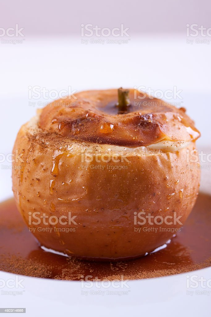 Baked apple with cottage cheese stock photo