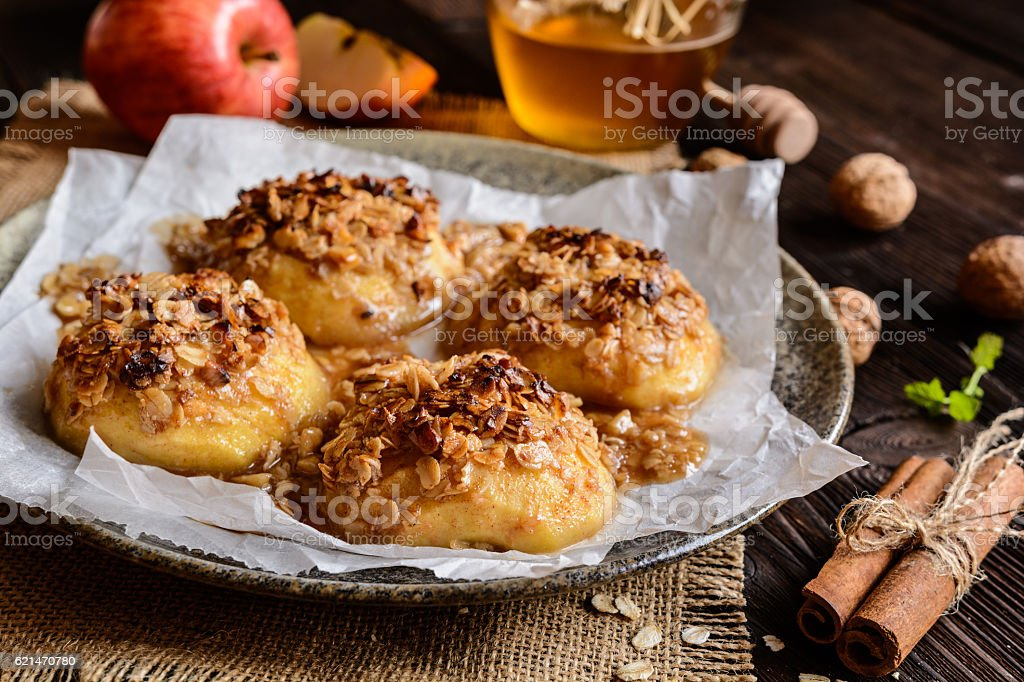 Baked apple with oatmeal, walnuts, honey and cinnamon stock photo